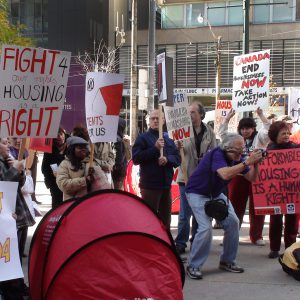 Fight for our rights. Housing is a right. Canada end homlessness, Take action now! Build housing now.